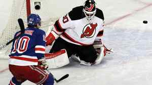 New Jersey Devils goalie Martin Brodeur, right, deflects a shot by New York Rangers' Marian Gaborik, of Slovakia. (AP Photo/Julio Cortez)