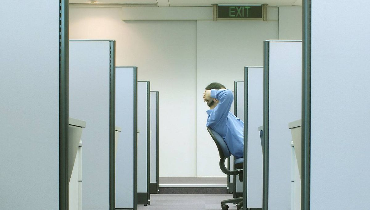 File #: 680093 man reclining on his chair in cubicle with EXIT sign above Credit: iStockphoto (Royalty-Free) Keywords: Cubicle, Office, Boredom, White Collar Worker, Working Late, Occupation, Business, Relaxation, Corridor