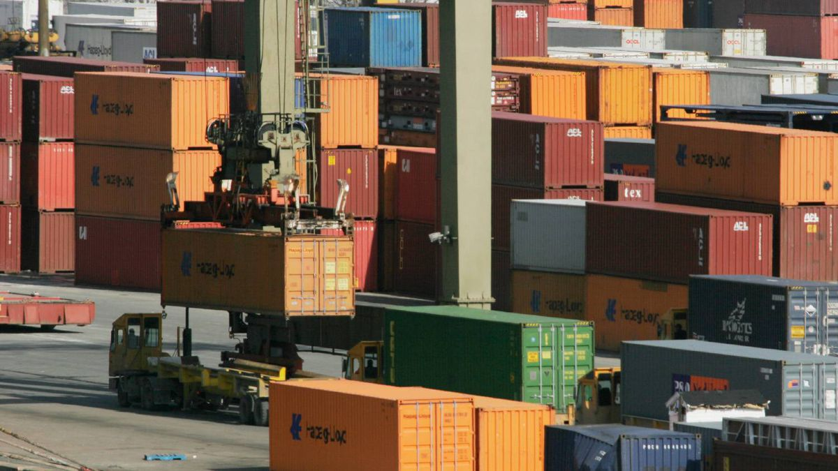 Containers are transferred to a cargo ship at the Ceres terminal in Halifax.