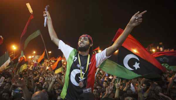 People celebrate the capture in Tripoli of Moammar Gadhafi's son and one-time heir apparent, Seif al-Islam, at the rebel-held town of Benghazi, Libya, early Monday.