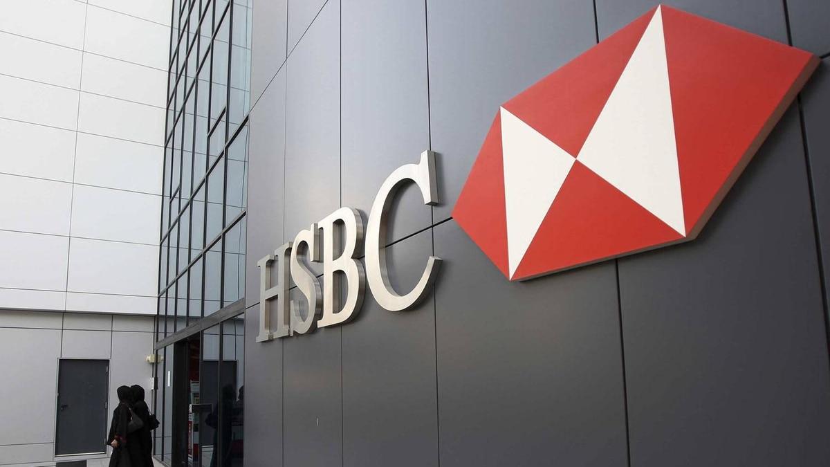Women walk out of a branch of HSBC at Dubai Internet City in Dubai February 5, 2012.