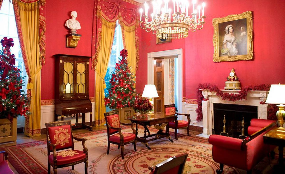 The Red Room of the White House, decorated with cranberry garland and cranberry wreaths, with two Fraser Fir Christmas trees, is seen during a press tour of the holiday decorations in Washington, DC, on December 2, 2009.