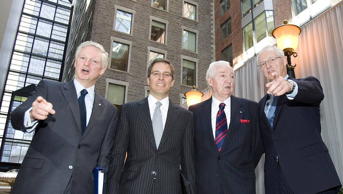 Jeffrey Orr (second left), president and chief executive officer of Power Financial Corp., poses for a photo with Power Financial co-chairs Paul Desmarais Jr. (left), his brother Andre Desmarais (far right) and Paul Desmarais (second right), chairman of the executive committee of Power Corporation of Canada prior to the company's annual general meeting in Montreal, May 12, 2009.