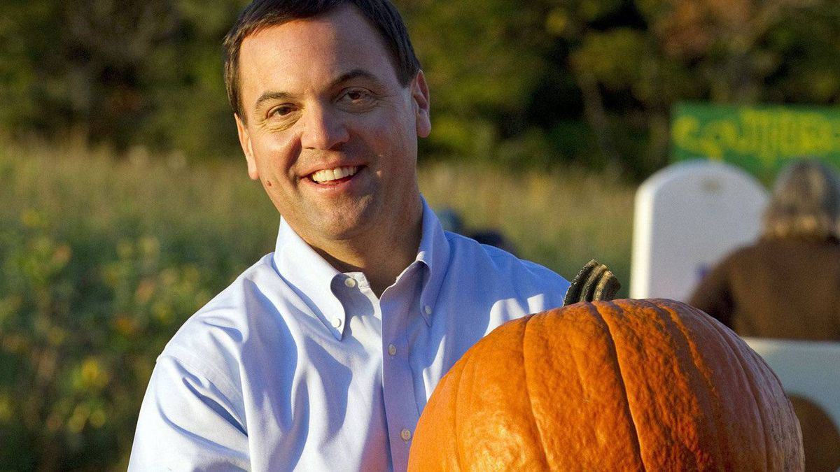 Ontario Progressive Conservative Leader Tim Hudak carries a pumpkin at a campaign stop in Vaughan on Oct. 4, 2011.