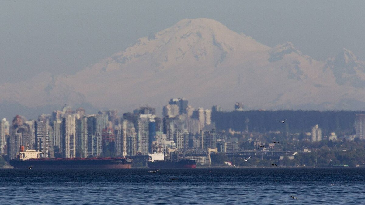 The snow capped slopes of Mount Baker in Washington State looms over Vancouver and freighters anchored in English Bay Monday, May 14, 2012.