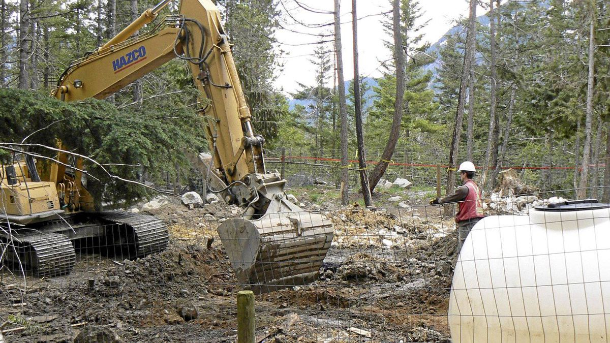 BC SPCA investigators continue to excavate and carry out site mapping prior to the exhumation of what is believed to be the mass grave site of 100 sled dogs near Whistler.