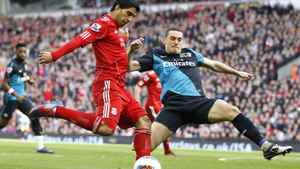 Liverpool's Luis Suarez is challenged by Arsenal's Thomas Vermaelen during their English Premier League match at Anfield in Liverpool, March 3, 2012.