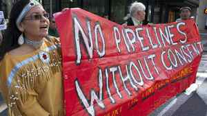 Natives from the Yinka Dene Alliance march through downtown Calgary in May to protest Enbridge Pipeline's Northern Gateway project.