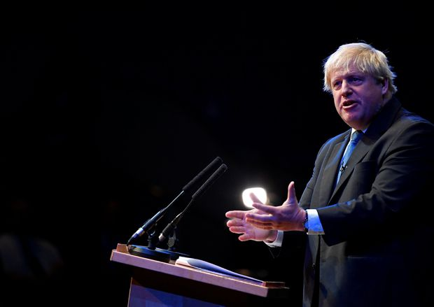 Johnson assaults May's Brexit plan at fractious party meeting