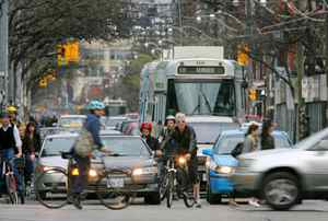 Cyclists, pedestrians and cars vie for space on Toronto's streets in May of 2009.