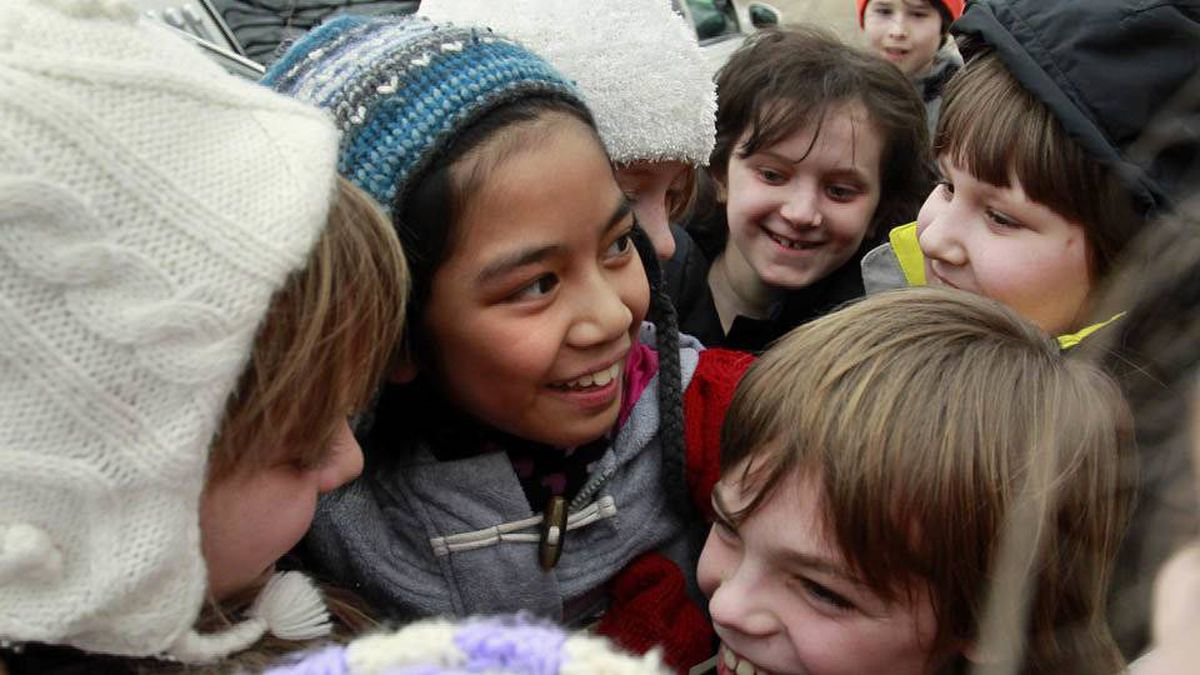 Ten-year-old Maria Aragon is greeted by her classmates at Isaac Brock School in Winnipeg on Thursday, Feb. 17, 2011.