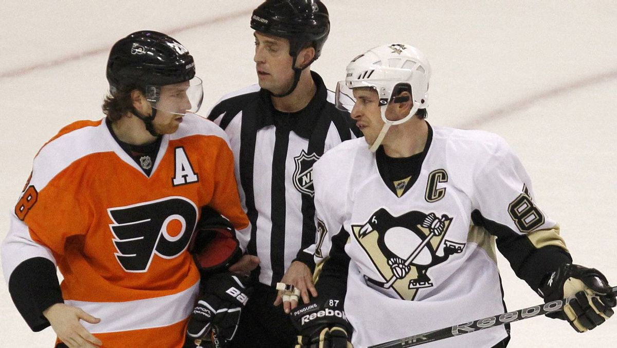 Pittsburgh Penguins' Sidney Crosby (R) talks with Philadelphia Flyers' Claude Giroux (L) during the first period in Game 3 of their NHL Eastern Conference quarterfinal playoff hockey series in Philadelphia, April 15, 2012. REUTERS/Tim Shaffer