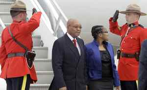 South African President Jacob Zuma, and his daughter Phumzile, are greeted by Royal Canadian Mounted Police as they arrive in advance of the G8 and G20 Summit, Thursday, June 24, 2010, at Pearson International Airport in Toronto.