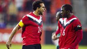 Canada's Dwayne De Rosario (L) celebrates his goal against St. Kitts and Nevis with teammate Olivier Occean during their 2014 World Cup qualifying soccer match in Toronto November 15, 2011.