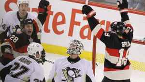 Pittsburgh Penguins goaltender Brent Johnson looks up as Ottawa Senators' Jason Spezza (19) and Zenon Knopka (28) celebrate Knopka's goal during second period NHL hockey action in Ottawa Friday December 16, 2011. THE CANADIAN PRESS/Fred Chartrand