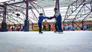 Jason Rokosh and Sophie Rokosh, four, try out Toronto's Evergreen Brick Works skating path. Malls and other commercial spaces are using skating rinks to get Canadians off the couch.