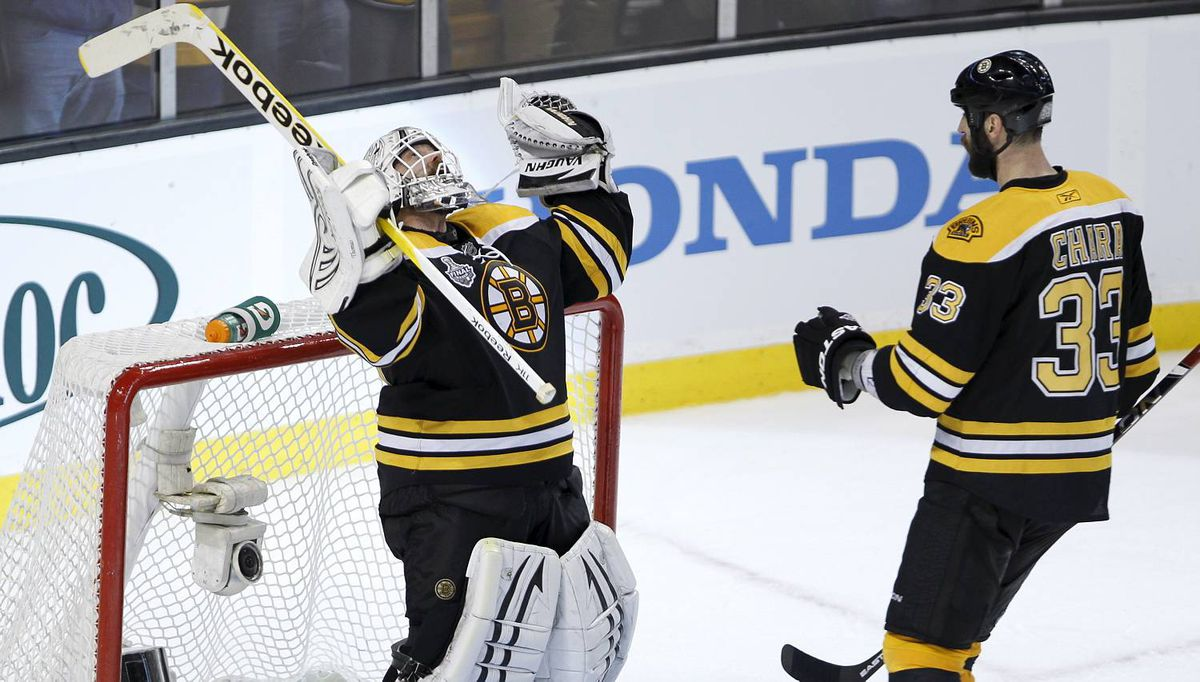 Boston Bruins Tim Thomas celebrates during the third period of the NHL Stanley Cup Final Game 6 in Boston on June 13, 2011. The Boston Bruins tied the series at three games apiece with a 5-2 victory over the Vancouver Canucks. (Photo by Peter Power/The Globe and Mail)