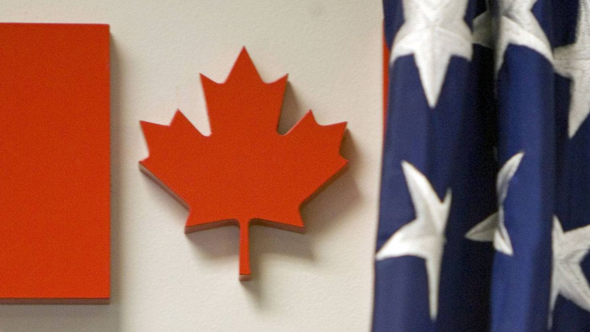 The Maple Leaf and U.S. flag are seen at the Nexus border office at Pearson airport in Toronto on Sept. 17, 2007.