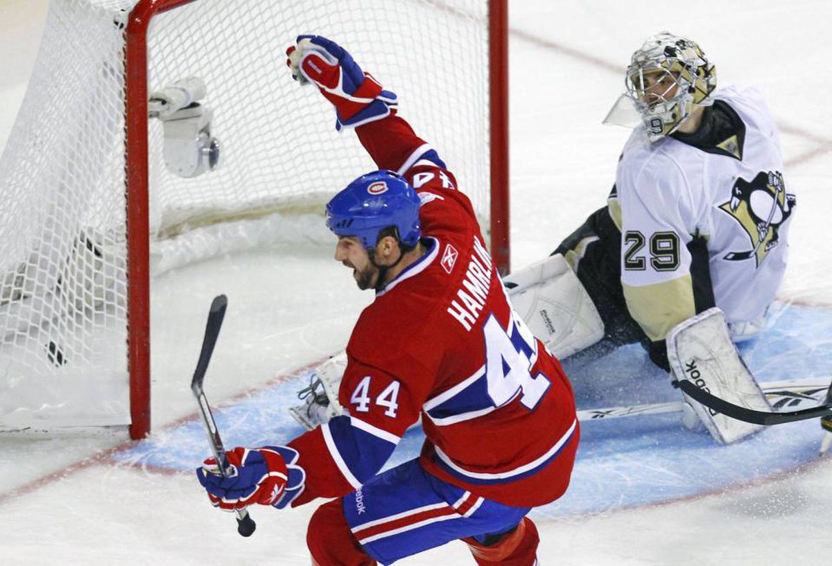 Montreal Canadiens Roman Hamrlik celebrates his team's goal on Pittsburgh Penguins goalie Marc-Andre Fleury during the third period in Game 4 of their NHL Eastern Conference semi-final hockey series in Montreal, May 6, 2010.