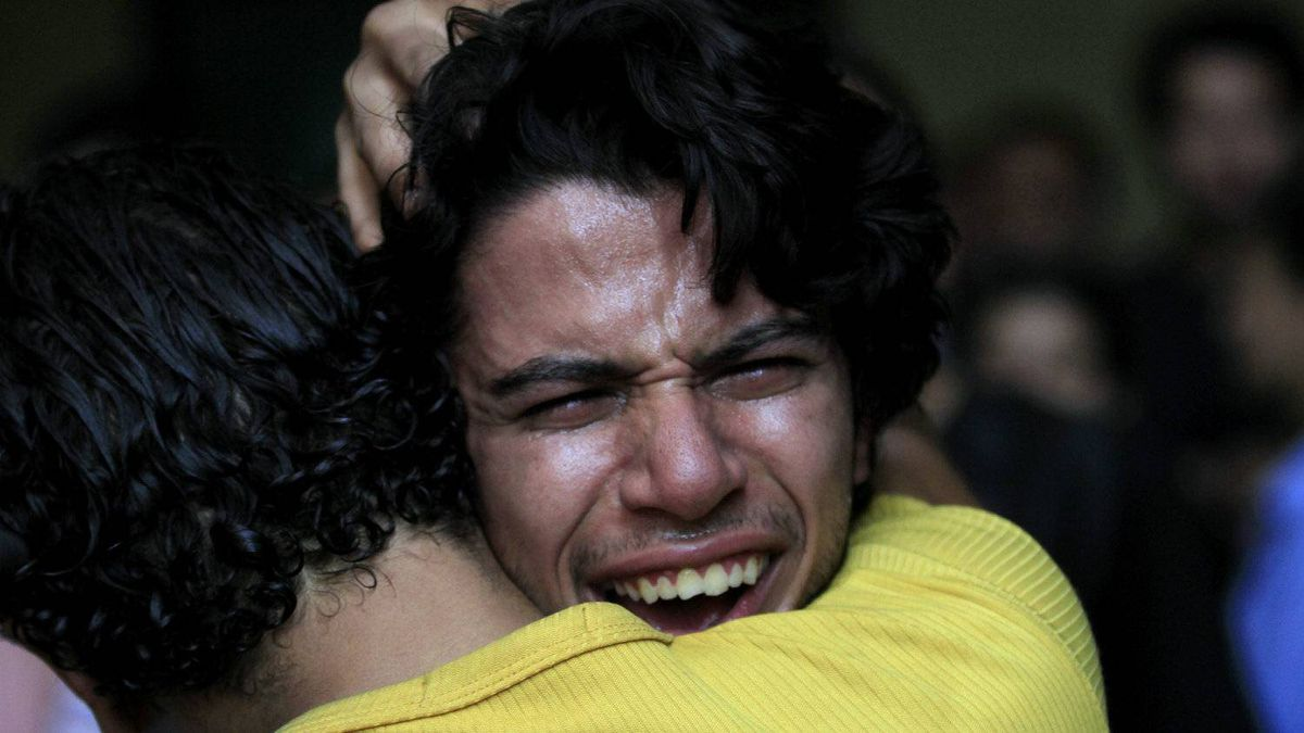 Egyptian relatives of 17 of the Copts who were killed during clashes with the Egyptian army late Sunday, react after seeing their bodies outside the morgue of the Copts hospital in Cairo, Egypt, Monday, Oct. 10, 2011.