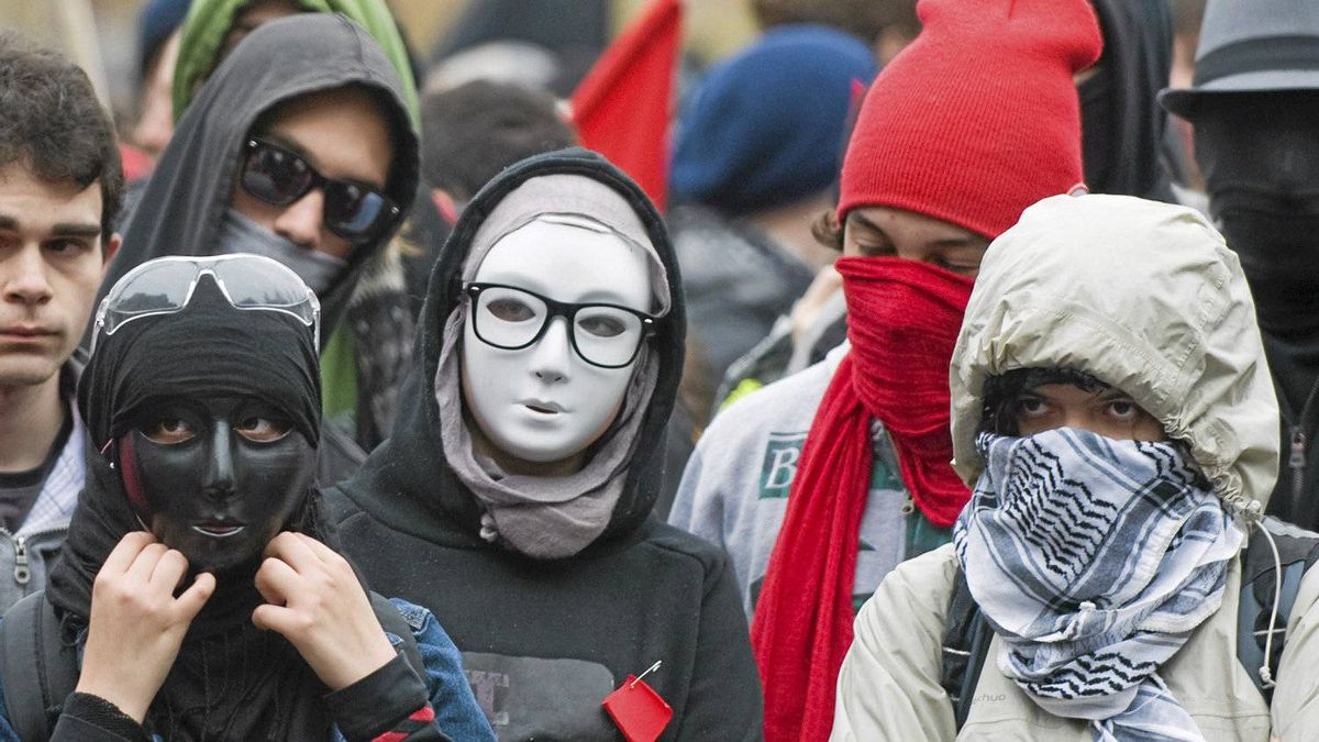 Masked protesters take part in an anti-capitalist demonstration in Montreal, Tuesday, May 1, 2012. Conservative MPs have agreed to impose a maximum 10-year prison term on protesters who wear masks during a riot.