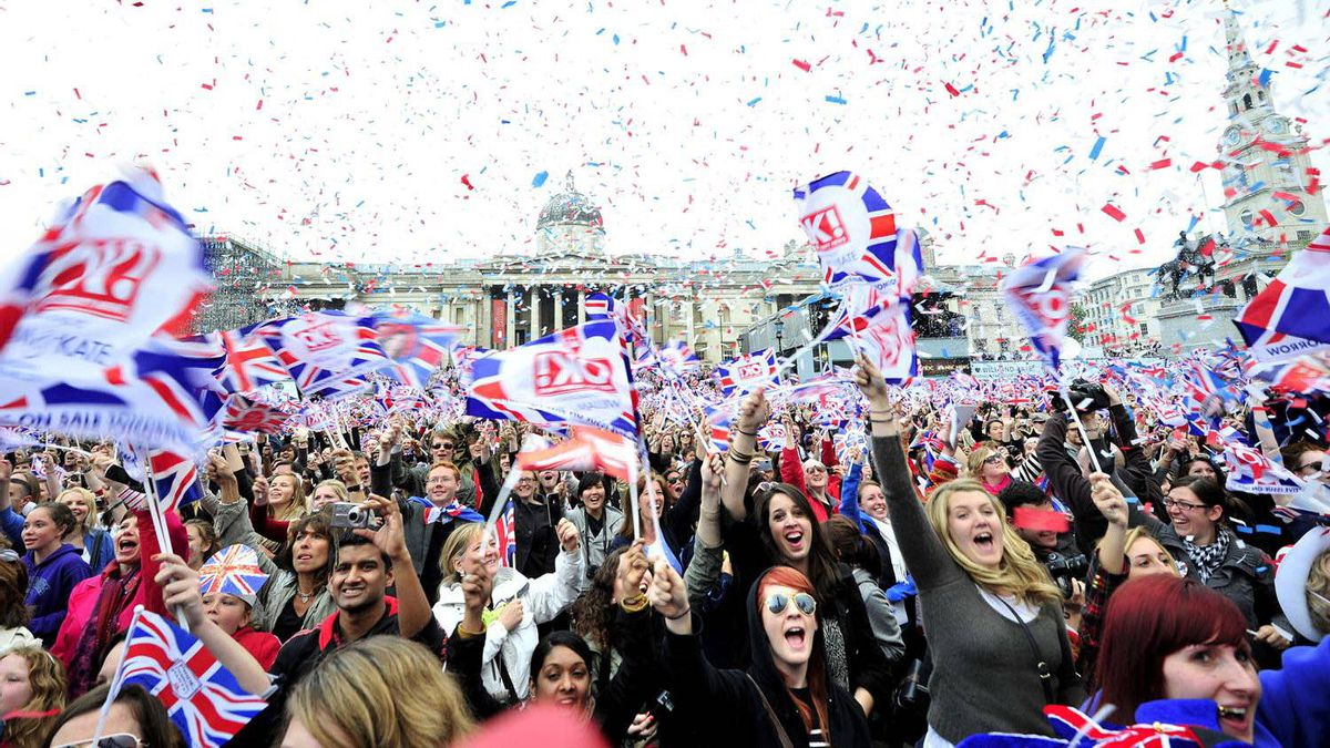 Royal supporters celebrate after Britain's Prince William and Kate, Duchess of Cambridge's wedding service in Trafalgar Square, in London, on April 29, 2011.