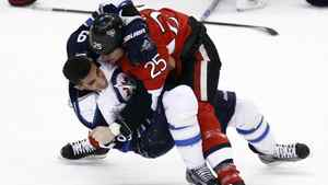 Ottawa Senator Chris Neil fights with Winnipeg Jet Evander Kane during the first period on Jan. 16, 2012.