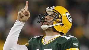 Green Bay Packers' Aaron Rodgers reacts to a touchdown pass during the second half of an NFL football game against the Chicago Bears Sunday, Dec. 25, 2011, in Green Bay, Wis. (AP Photo/Jeffrey Phelps)