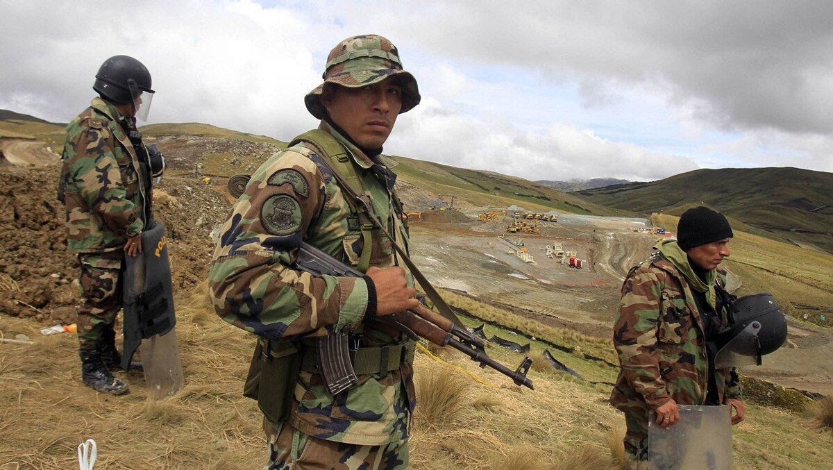 Police officers guard near machinery of Newmont's proposed $4.8-billion Conga gold mine to protect it from protesters near the Cortada lagoon in the Andean region of Cajamarca.