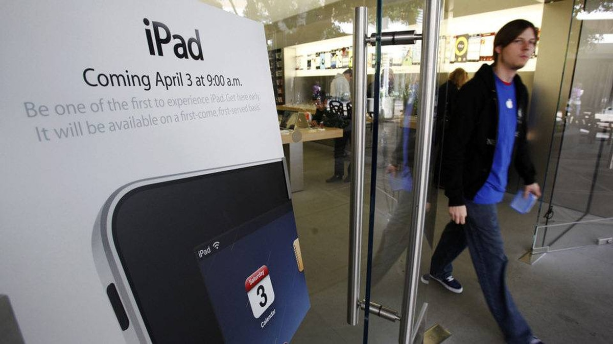 In this photo made Tuesday, March 30, 2010, an iPad advertisement is seen at an Apple Store in Palo Alto, Calif. A whole lot of people are willing to plunk down their money for an iPad, sight unseen, hoping it will turn out to be the missing link in their digital lives.