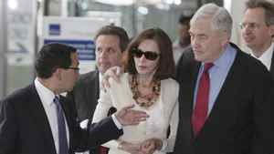 Former media mogul Conrad Black and his wife Barbara Amiel Black listen to attorney Miguel Estrada as they leave Federal court Friday, June 24, 2011, in Chicago, after his resentencing hearing, where a judge decided he had not spent enough time behind bars.