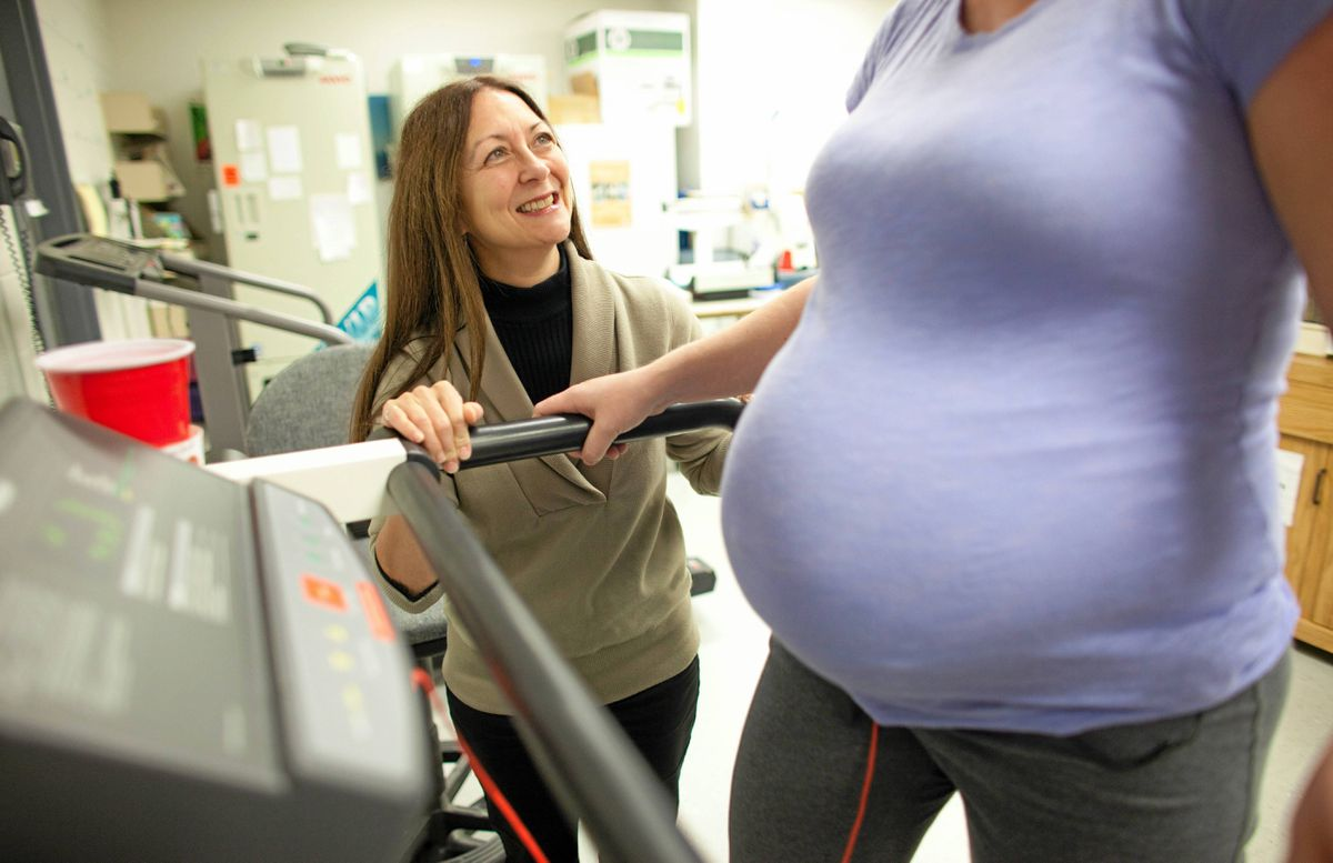 Michelle Mottola talks with an expectant mom in the Exercise and Pregnancy Lab at the University of Western Ontario October 28, 2011.