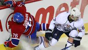 Montreal Canadiens P.K. Subban (76) is tripped into the boards by Edmonton Oilers Gilbert Brule (67) during the second period of their NHL hockey game in Montreal, December 1, 2010.
