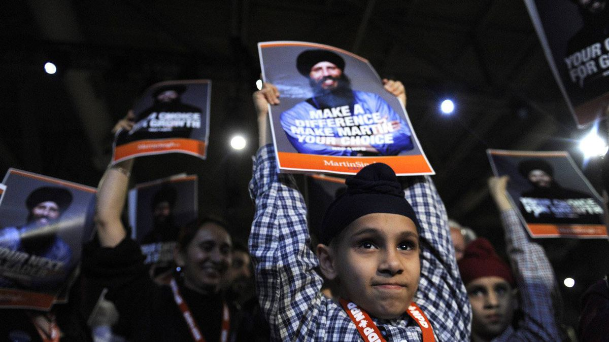 Haramrit Singh,10, holds up sign for his dad NDP leadership candidate Martin Singh during the NDP leadership convention on March 23 2012.