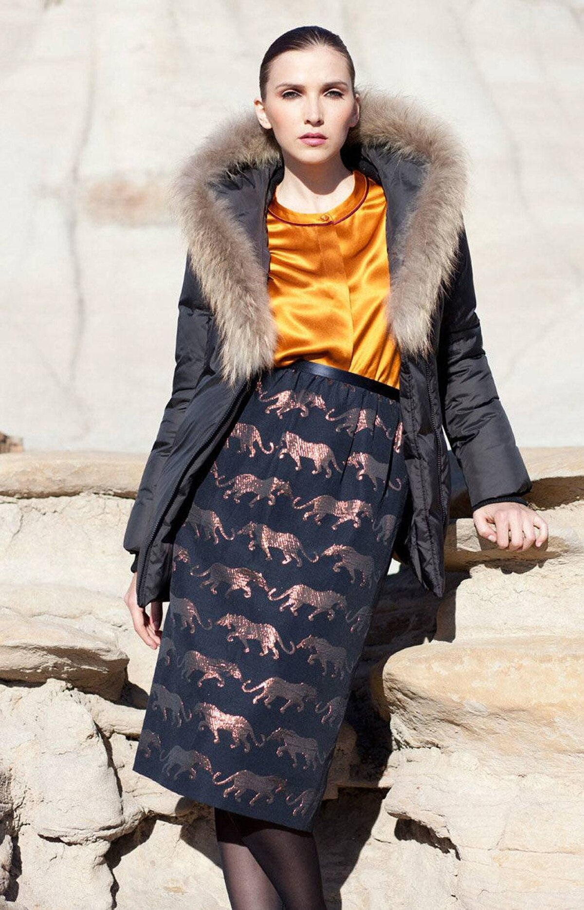THE PARKA Mackage parka, $59 Marc by Marc Jacobs top, $305, skirt, $390 at Holt Renfrew. Photo shoot credits: Styling by Tiyana Grulovic; styling assistant, Jennie Lyle; hair and makeup by Alicja Wilkosz. Special thanks to the Alberta Tourism Board.