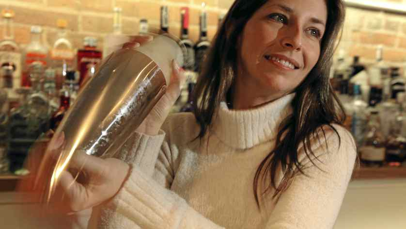 Sabrina Greer, a mixologist with The Martini Club mixes up a Cinnamon Sidecar.