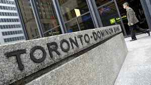 May 26, 2011. Pedestrian walk past the TD Canada-Trust Head office in Toronto, May 26, 2011. The bank posted a $1.33 Billion quarterly profit (J.P. Moczulski for The Globe and Mail)