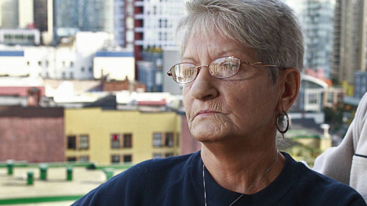 Lilliane Beaudoin looks out over downtown Vancouver from their hotel October 14, 2011. Ms. Beaudoin's adopted sister Dianne Rock is one of convicted serial murderer Robert Pickton's victims.