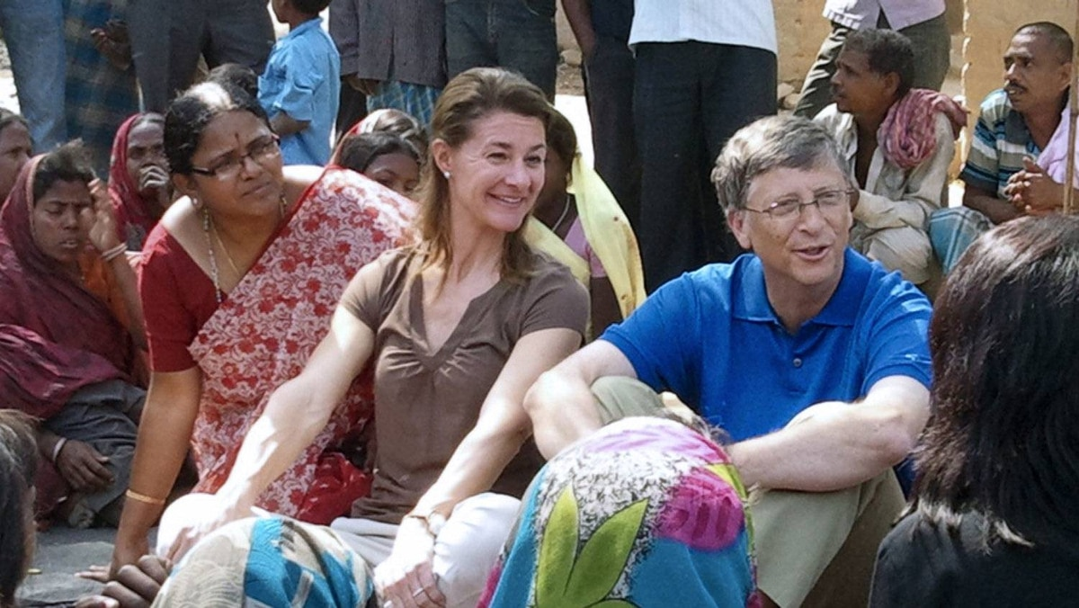 Melinda and Bill Gates interact with villagers during a trip to Patna district in India's Bihar's state on March 23, 2011.