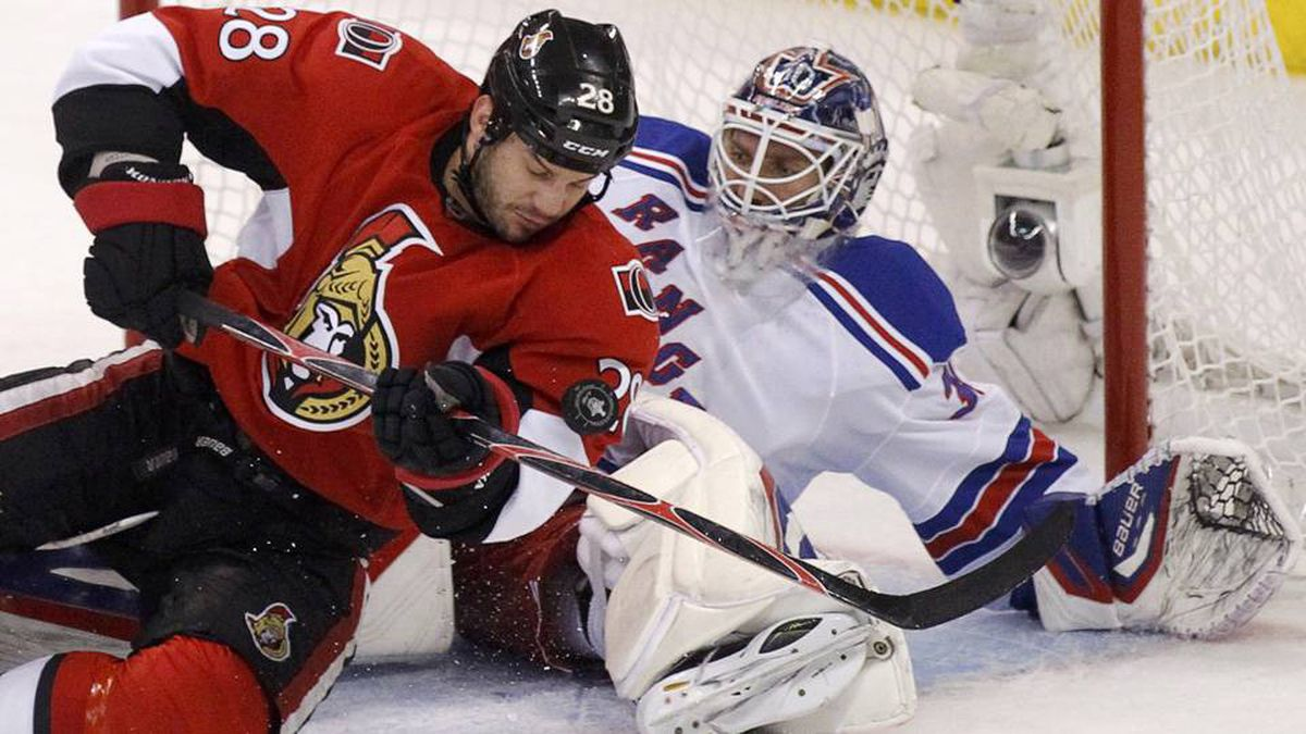 Ottawa Senators' Zenon Konopka (L) drives to the net on New York Rangers goalie Henrik Lundqvist during the first period in Game 3 of the NHL Eastern Conference quarter-final hockey playoff in Ottawa