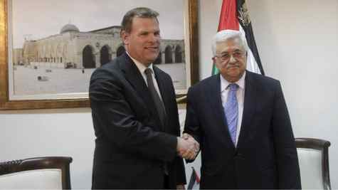 Palestinian President Mahmoud Abbas, right, and Canadian Foreign Minister John Baird, shake hands during a meeting in the West Bank city of Ramallah, Monday, Jan. 30, 2012.