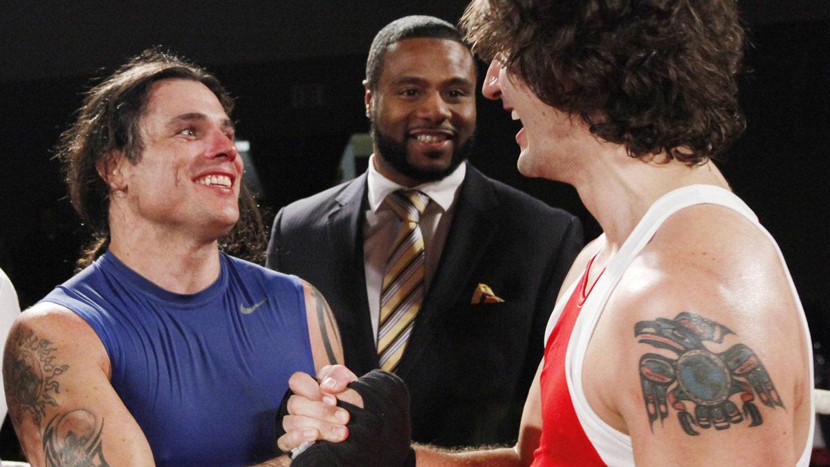Conservative Senator Patrick Brazeau congratulates Liberal MP Justin Trudeau after their charity boxing match for cancer research Saturday, March 31, 2012 in Ottawa.