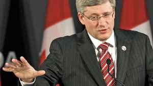 Prime Minister Stephen Harper speaks to reporters at the NATO Summit in Lisbon on Nov. 20, 2010.
