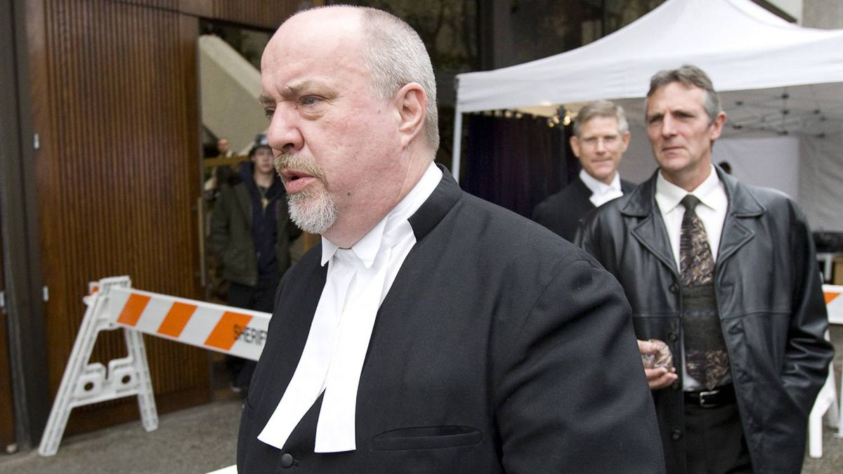 Lead crown prosecutor Mike Petrie, left and former head of the RCMP Missing Women Task Force, retired RCMP Insp. Don Adam, leave the B.C. Supreme Court in New Westminster, B.C. Tuesday, December 11, 2007. Families delivered their victim impact statements Tuesday before the sentencing of Robert Pickton who was found guilty in six counts of second-degree murder.