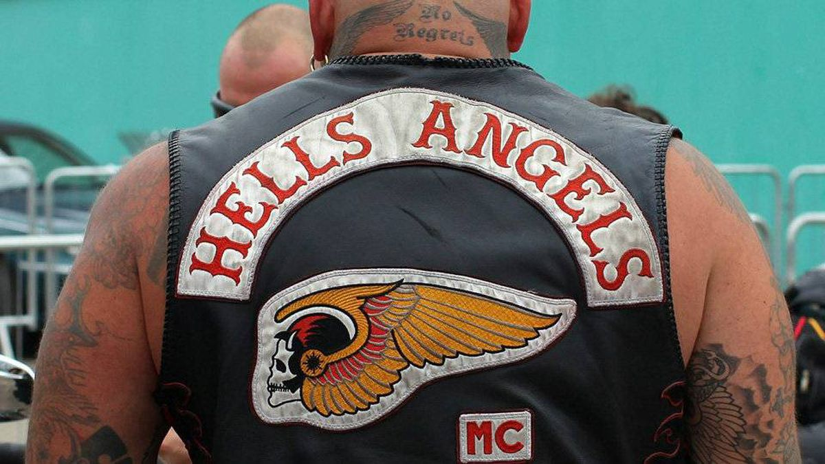 The Hells Angels 'Death Head' logo shown on the back of a jacket worn by a member in Stratford Upon Avon, England.