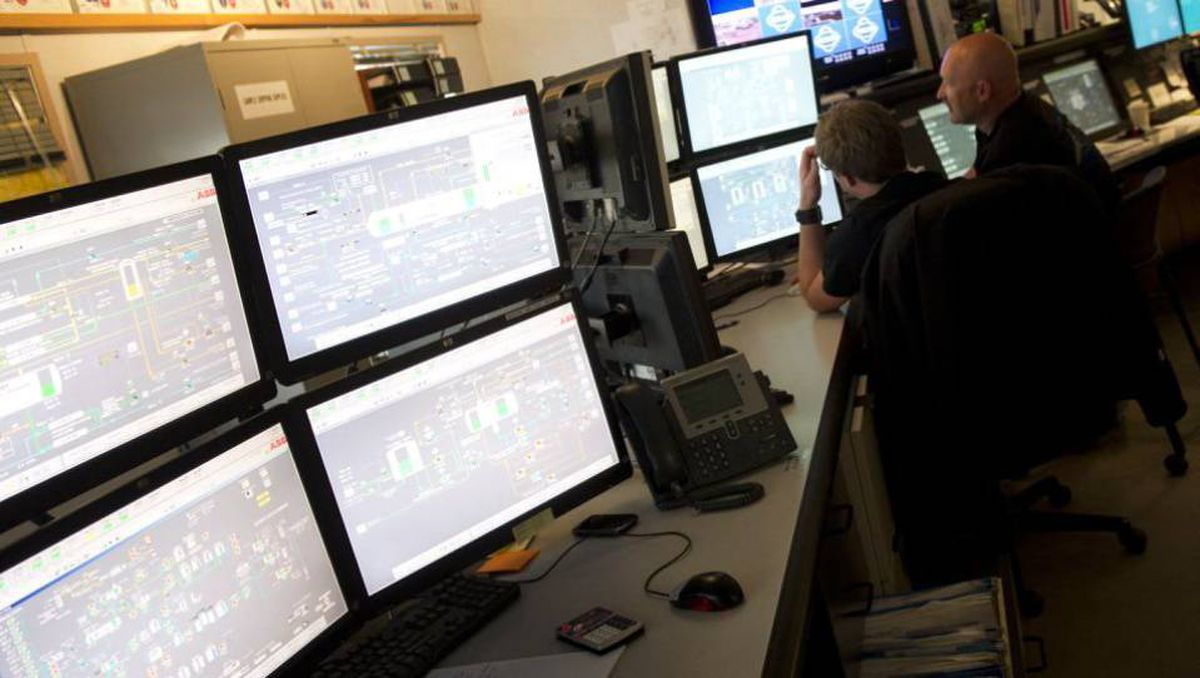 Staff monitor operations in the control room at Cenovus's Christina Lake operation south of Fort McMurray, Alta.