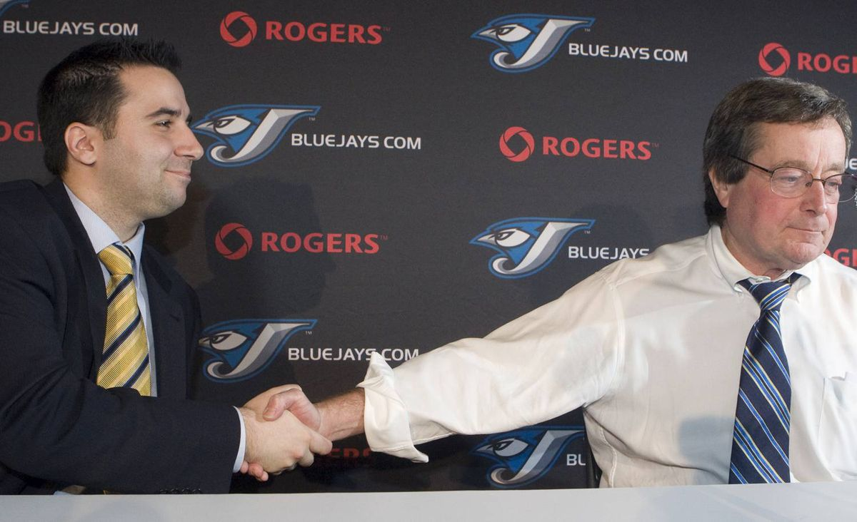 Toronto Blue Jays General Manager Alex Anthopoulos (left) shakes hands with President and CEO Paul Beeston.CP/File