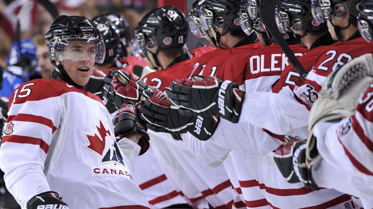 Canada's Tanner Pearson celebrates with teammates after scoring on Finland in the first period.