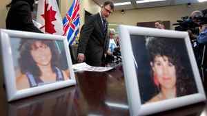 Photos of Robert Pickton victims Diane Rock, left, and Cara Ellis are displayed as British Columbia NDP leader Adrian Dix, centre, and Lilliane Beaudoin, Diane Rock's sister, arrive for a news conference in Vancouver, B.C., on Thursday March 29, 2012.