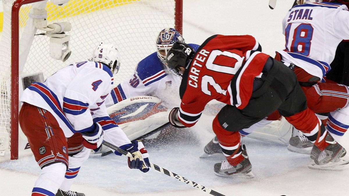 New Jersey Devils' Ryan Carter scores on New York Rangers goalie Henrik Lundqvist during the first period in Game 6 of their NHL Eastern Conference Final game in Newark, New Jersey, May 25, 2012.